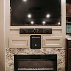 entertainment center with sound bar and fireplace