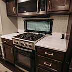 Microwave, range and kitchen cabinets