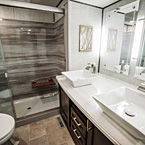 Bathroom showing porcelain toilet, 60 x 30 walk-in shower and dual vessel sinks w/waterfall faucets