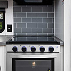 "3-Burner stove and 17"" oven with backlit LED controls and an easy to clean decorative backsplash"