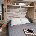 Queen bed with designer bedspread, large shirt wardrobes and shelving.