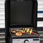 The optional Micro kitchen has a pull-out griddle and a 1.6 cu. ft. refrigerator. (Select models)