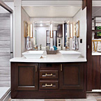 Dual Vessel Sinks w/ Waterfall faucet, Large Mirror and cabinetry in the Bathroom