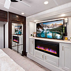 Retractable TV, Fireplace, Mirrored Closet and storage in the Bedroom (Shown with TV Up)